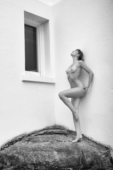 A nude woman and a Black Window.