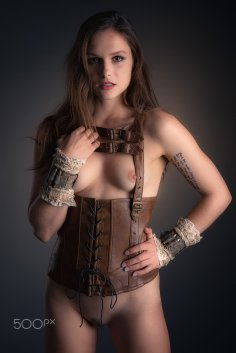 In leather camisole and with cuffs